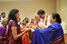Washington DC Indian wedding photographers catching groom welcome by bride's family
