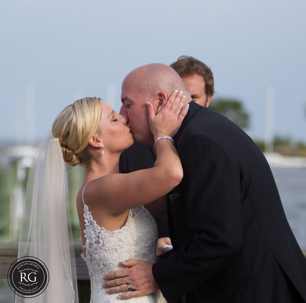 first kiss at wedding ceremony at Annapolis Maritime Museum