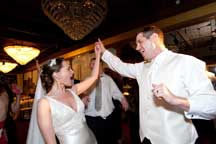 fun dancing photos of bride and groom at wedding reception by maryland wedding photographers